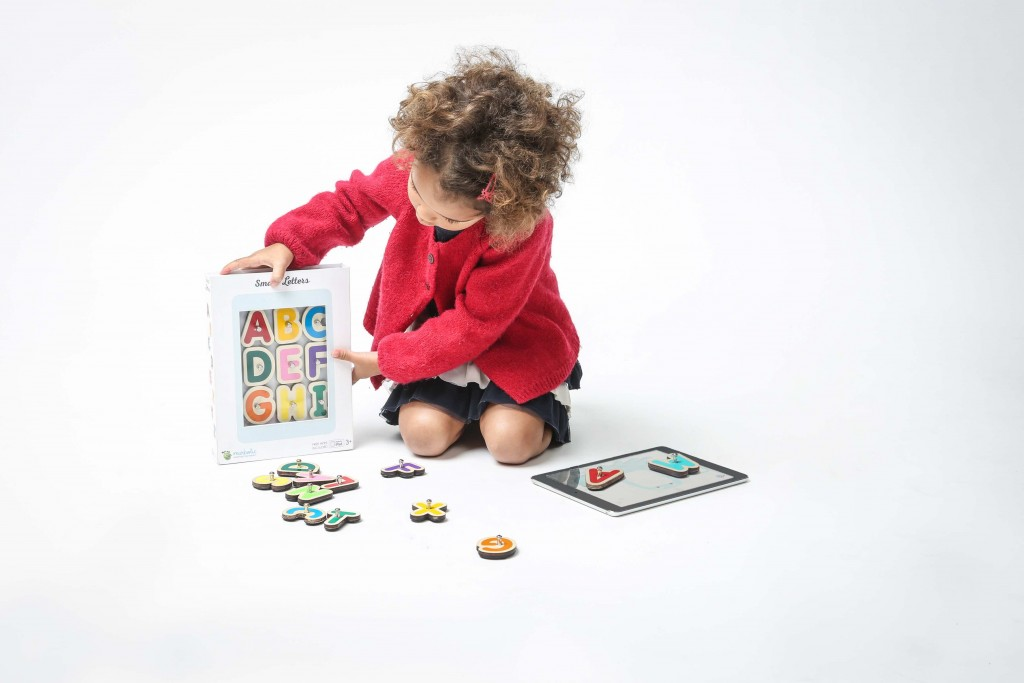 Girl playing smart letters